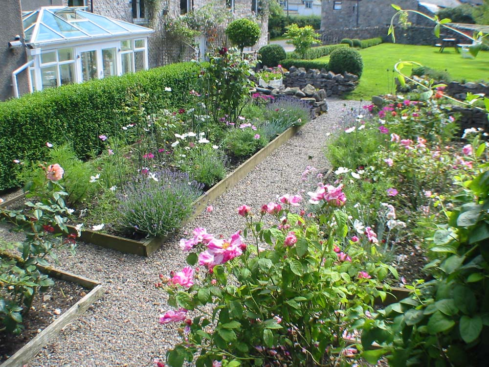 Roses In Garden: Huddlestone Cottage And The Hayloft Self-Catering Holiday