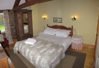 Huddlestone Cottage master bedroom with king size bed
