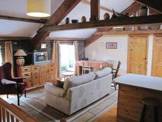 The Hayloft open plan living room with lofted ceiling
